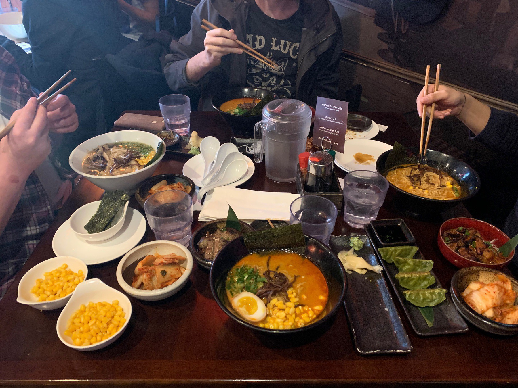 full table of food including sushi and ramen